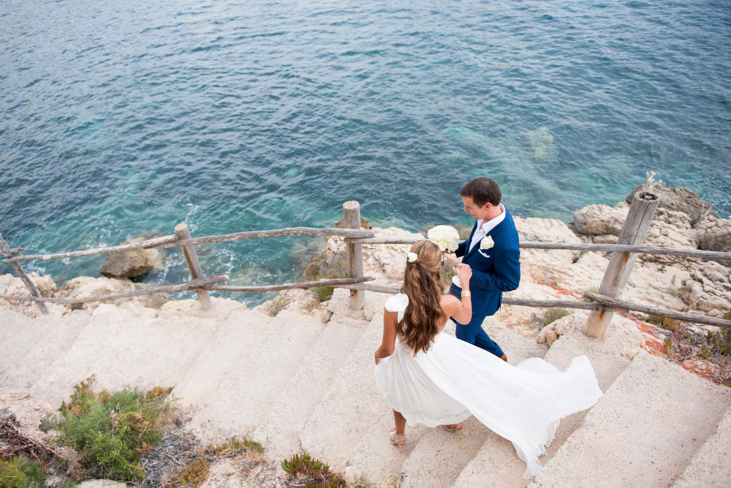 stairs seaside ceremony dress blowing wind couple es vedra