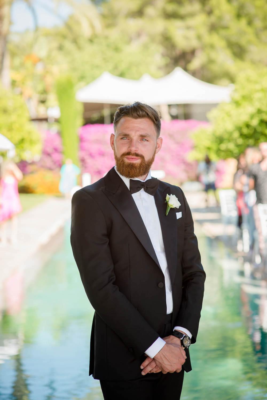 groom waiting black tie love sign
