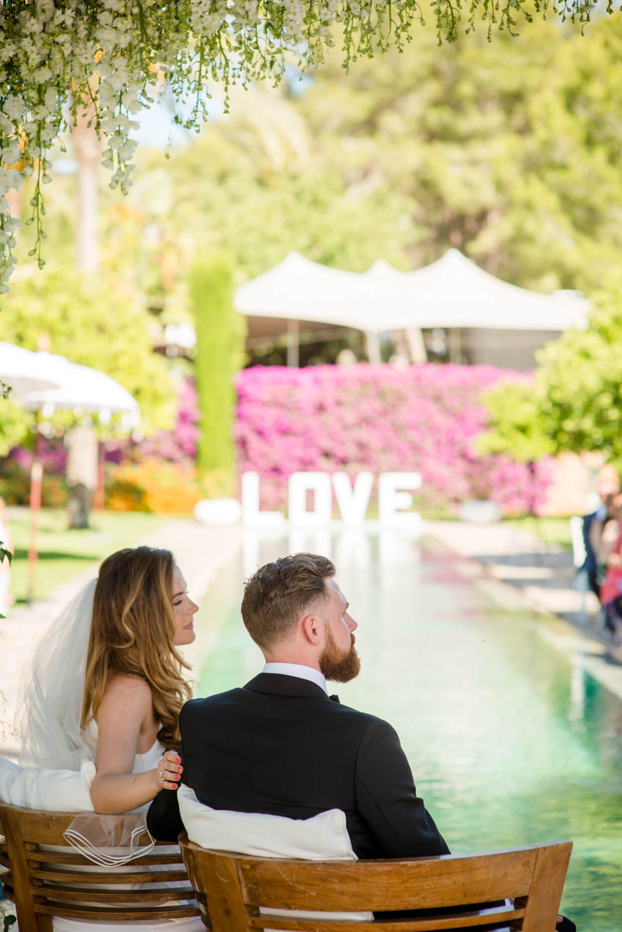 poolside wedding ceremony palm trees love sign