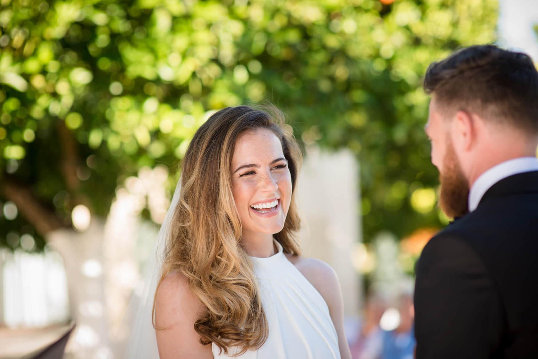bride ceremony vows happy laughter