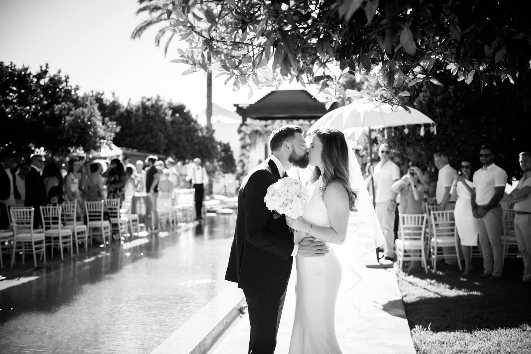 bride groom poolside ceremony exit first kiss