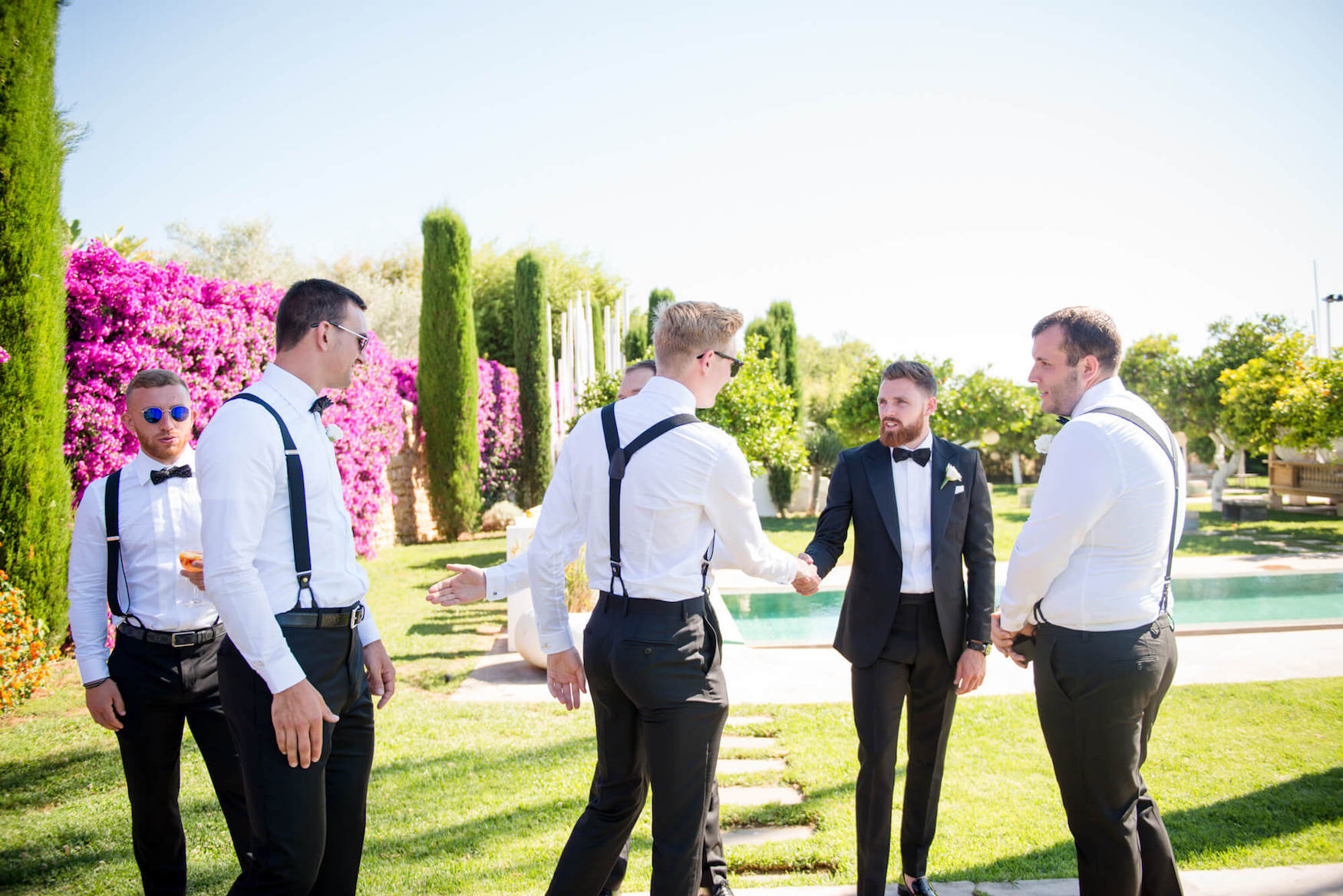 groom best men poolside ceremony