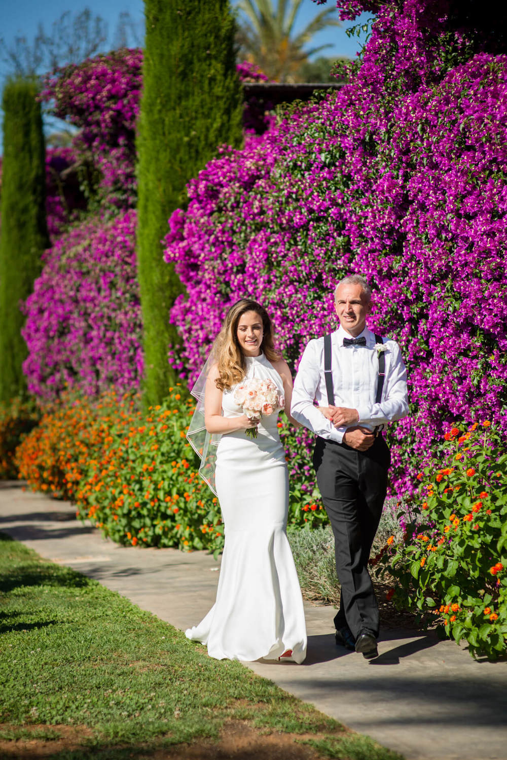bride father of bride entrance poolside ceremony bougainvillea