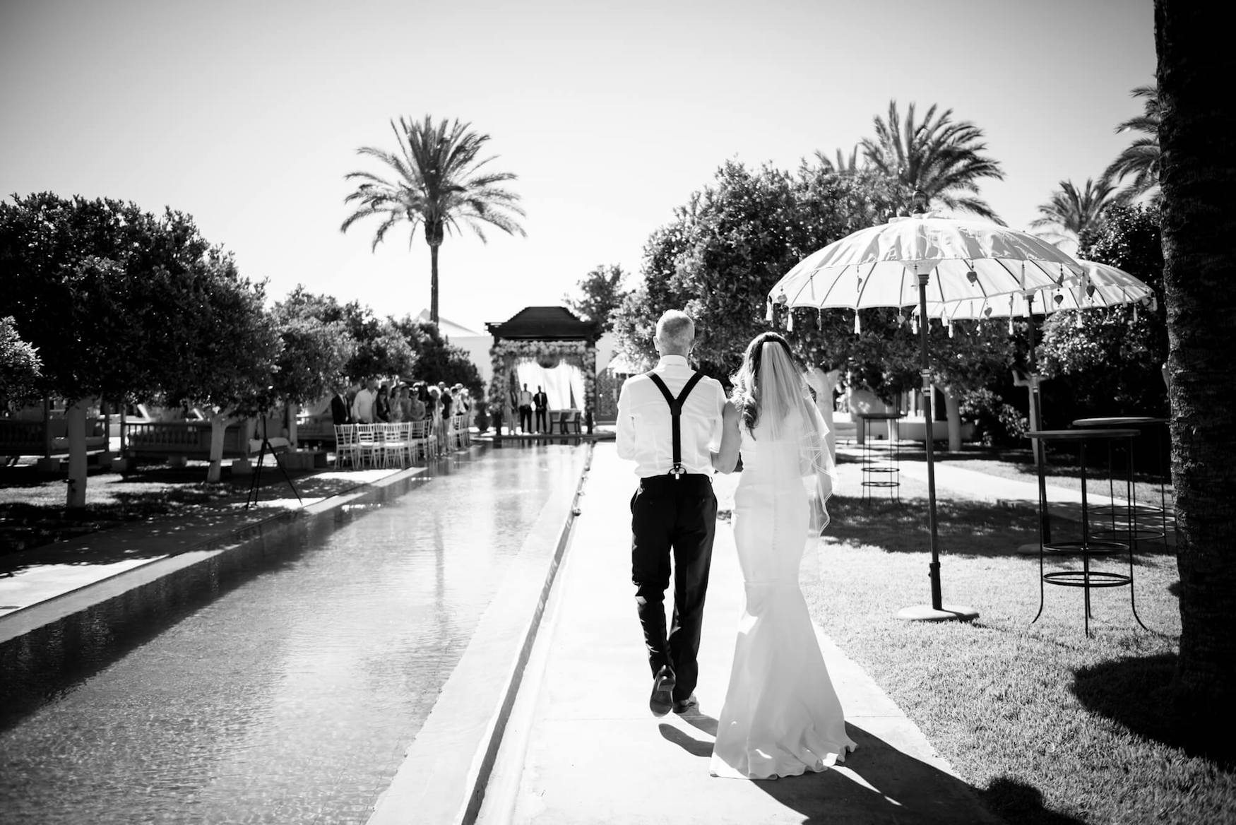bride father of bride entrance poolside ceremony palm trees