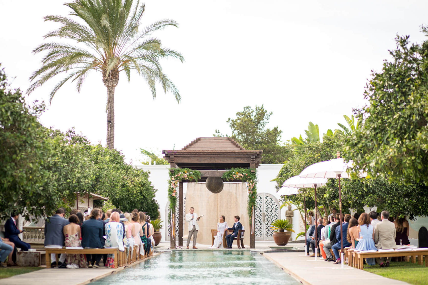 poolside wedding ceremony wedding arch pagoda