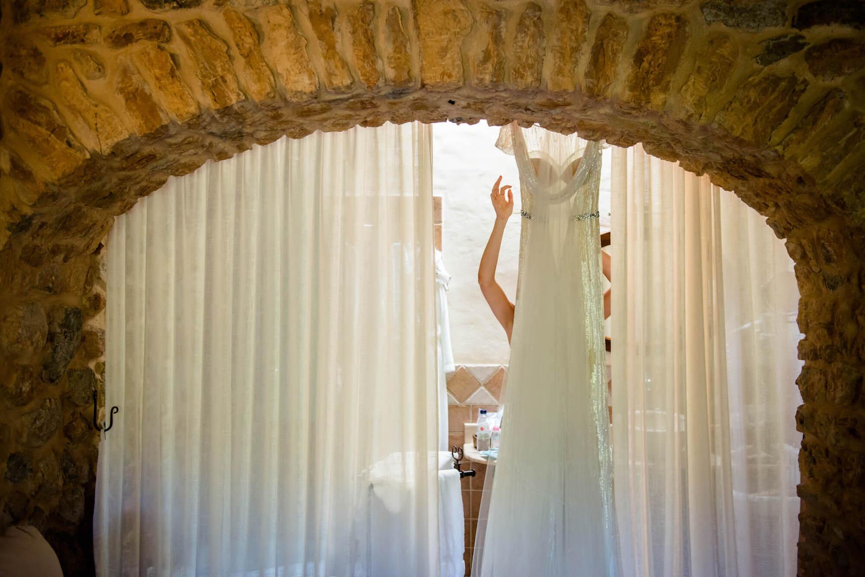 getting ready bride dress bathroom