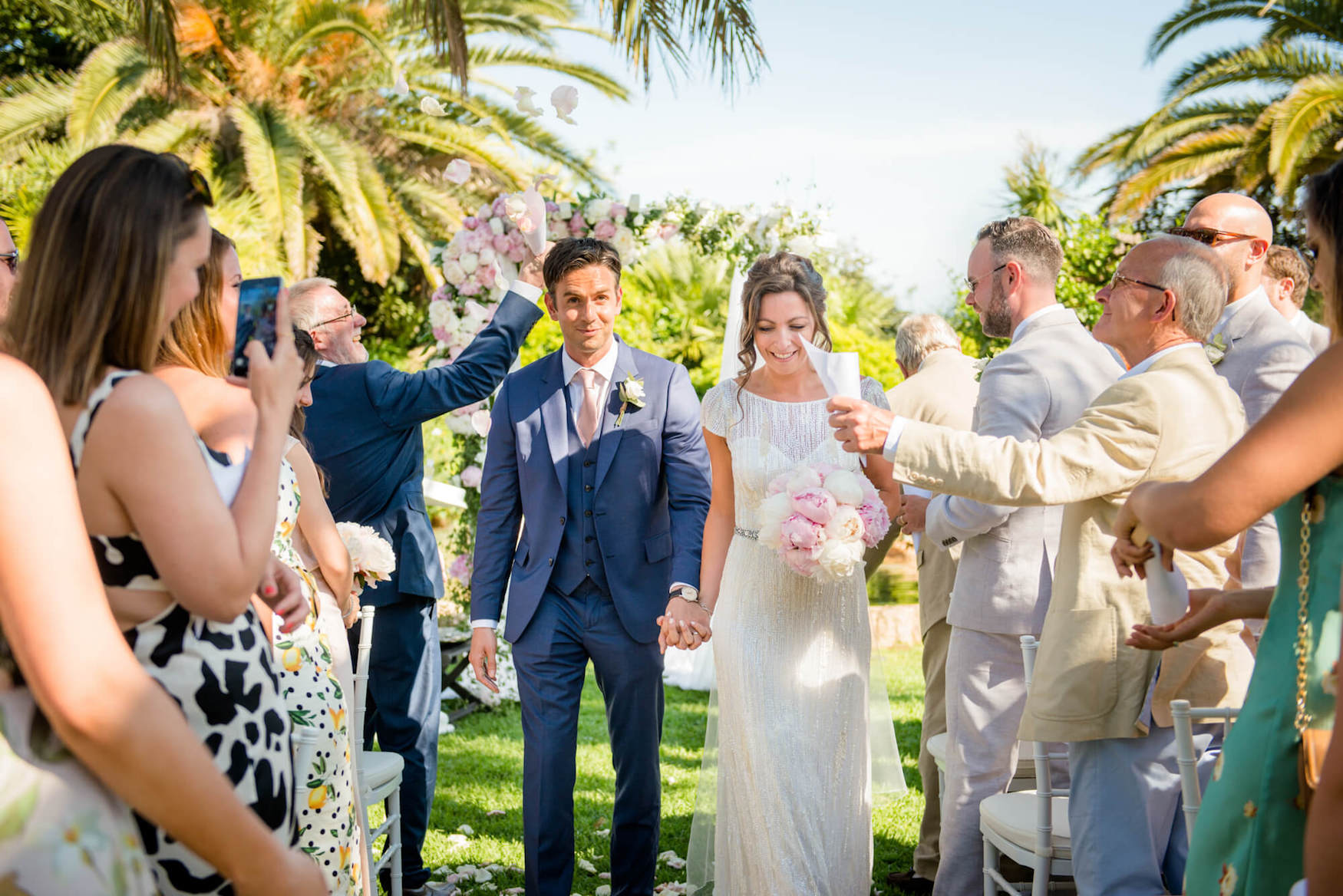 bride groom singing just married garden wedding ceremony palm trees