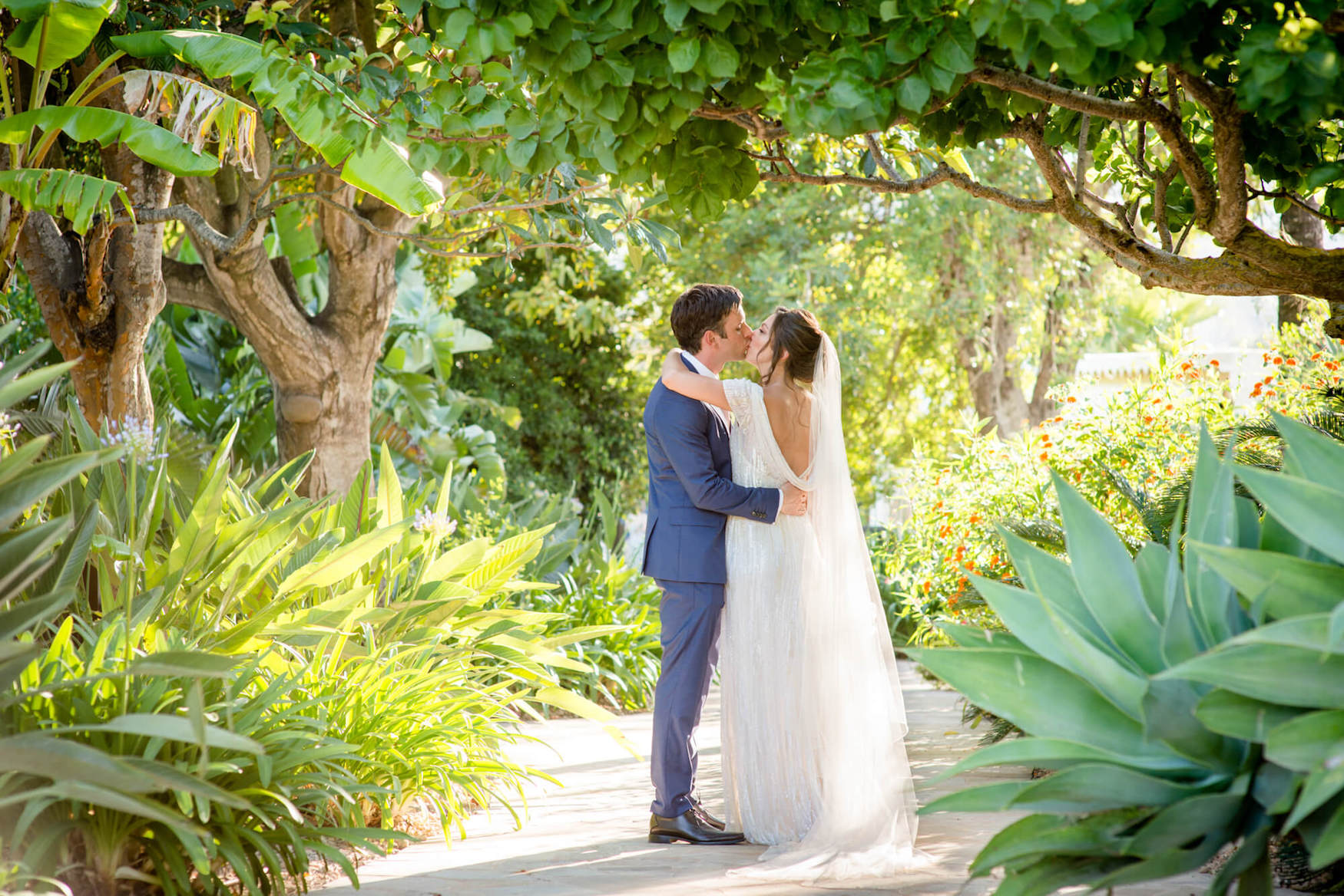 bride groom kiss lush green garden path dapled light eliza jane howell veil