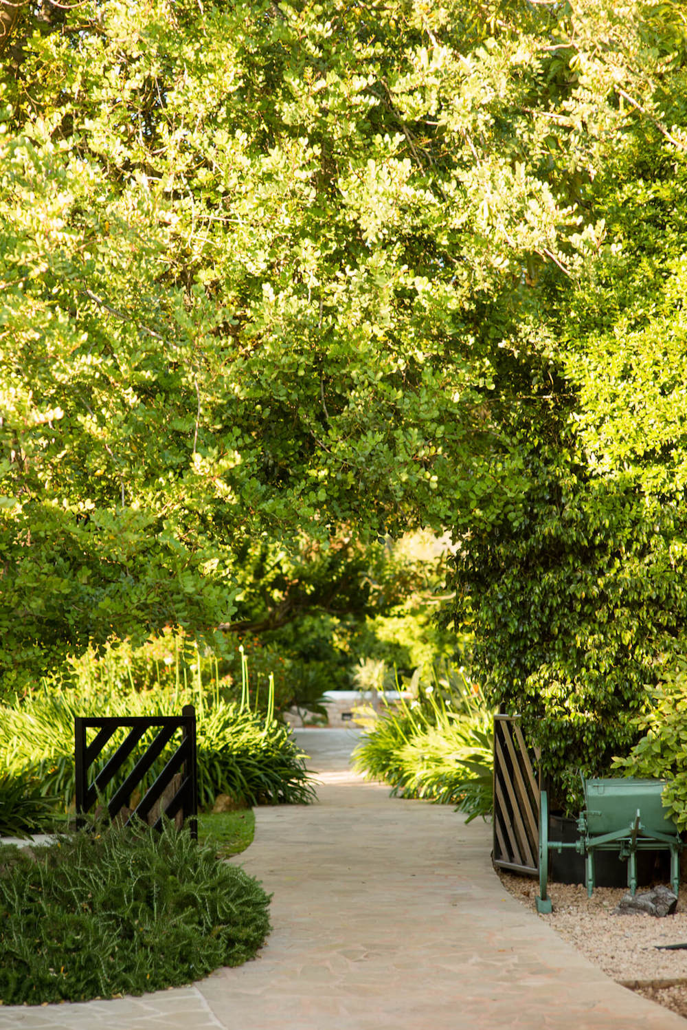 lush green garden gate rural hotel path
