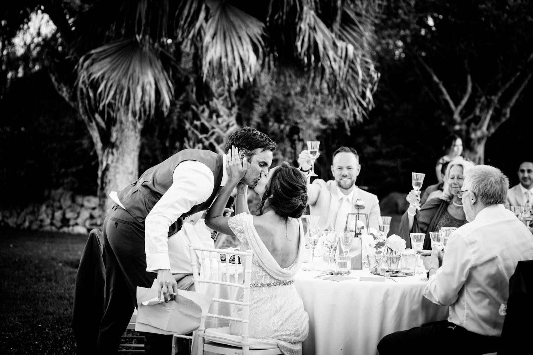 groom bride wedding speeches outdoor dinner cheers champagne