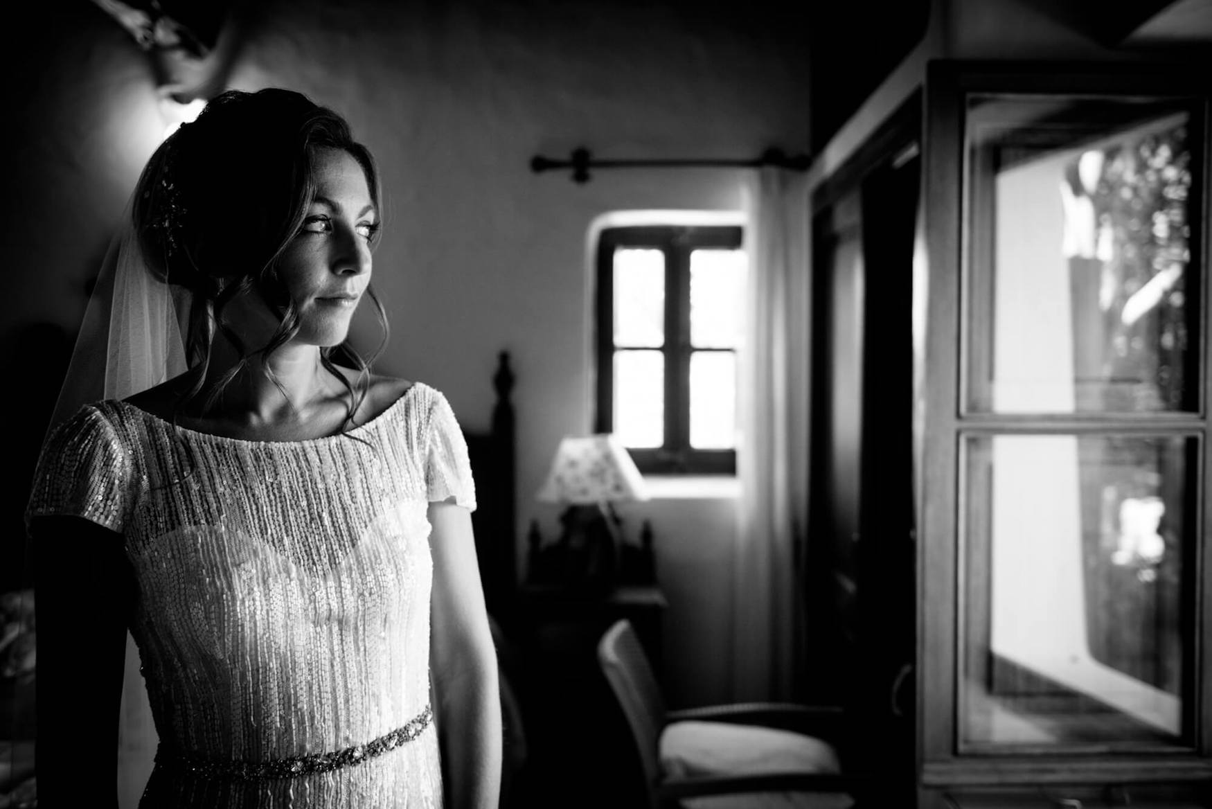 bride getting ready black white photo one side lighting