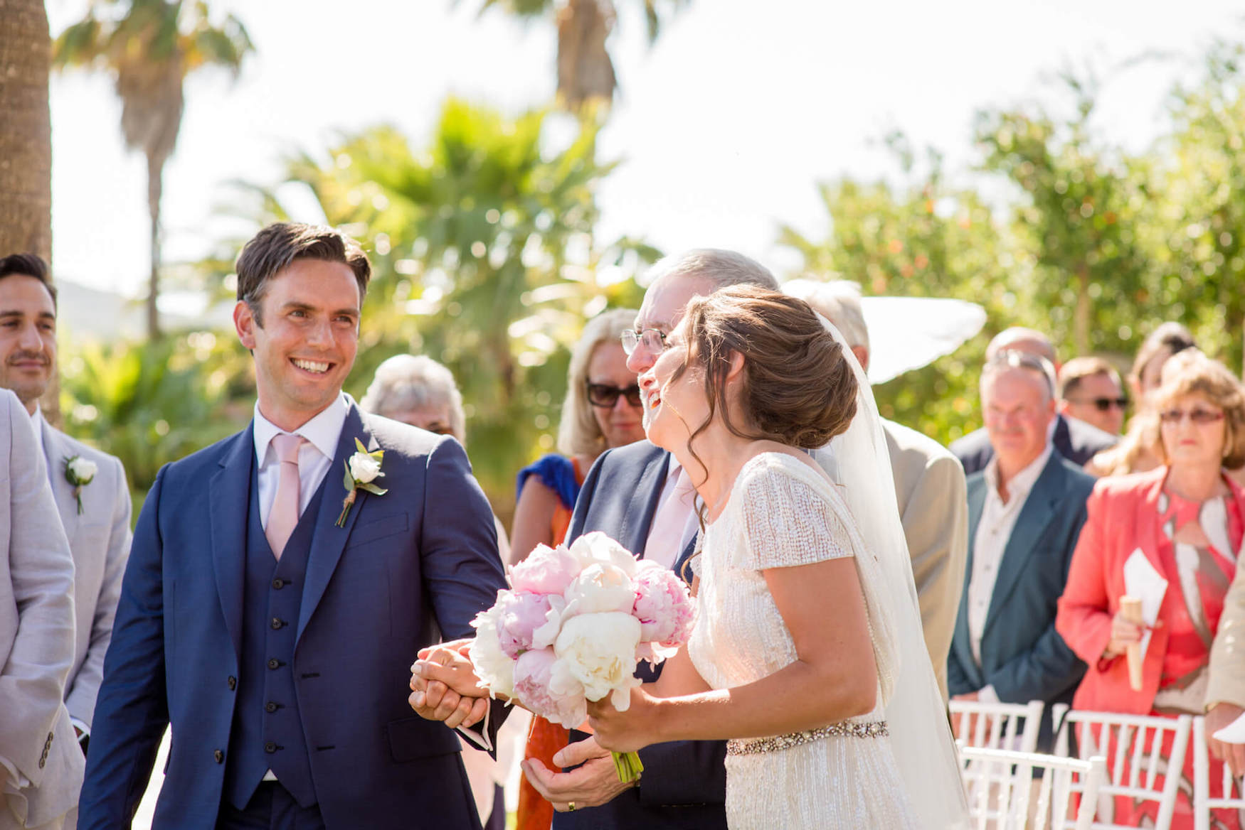 bride groom garden wedding ceremony palm trees laughter