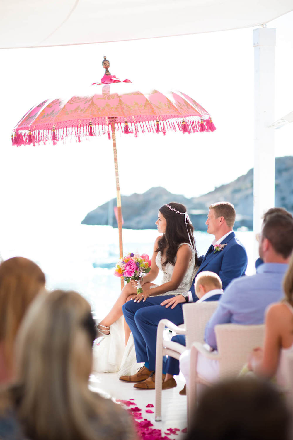 Colourful flower wedding ceremony bride groom beach venue sunset view Galia Lahav