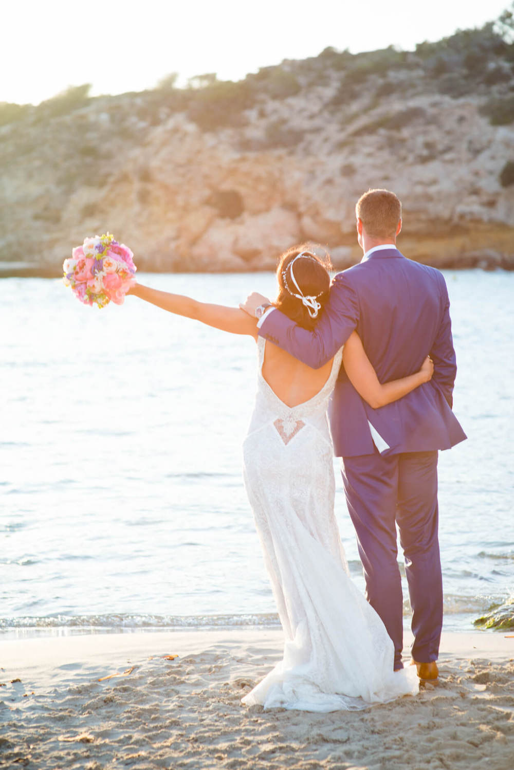 Colourful flowers wedding bouquet bride groom kiss beach venue sunset view Galia Lahav