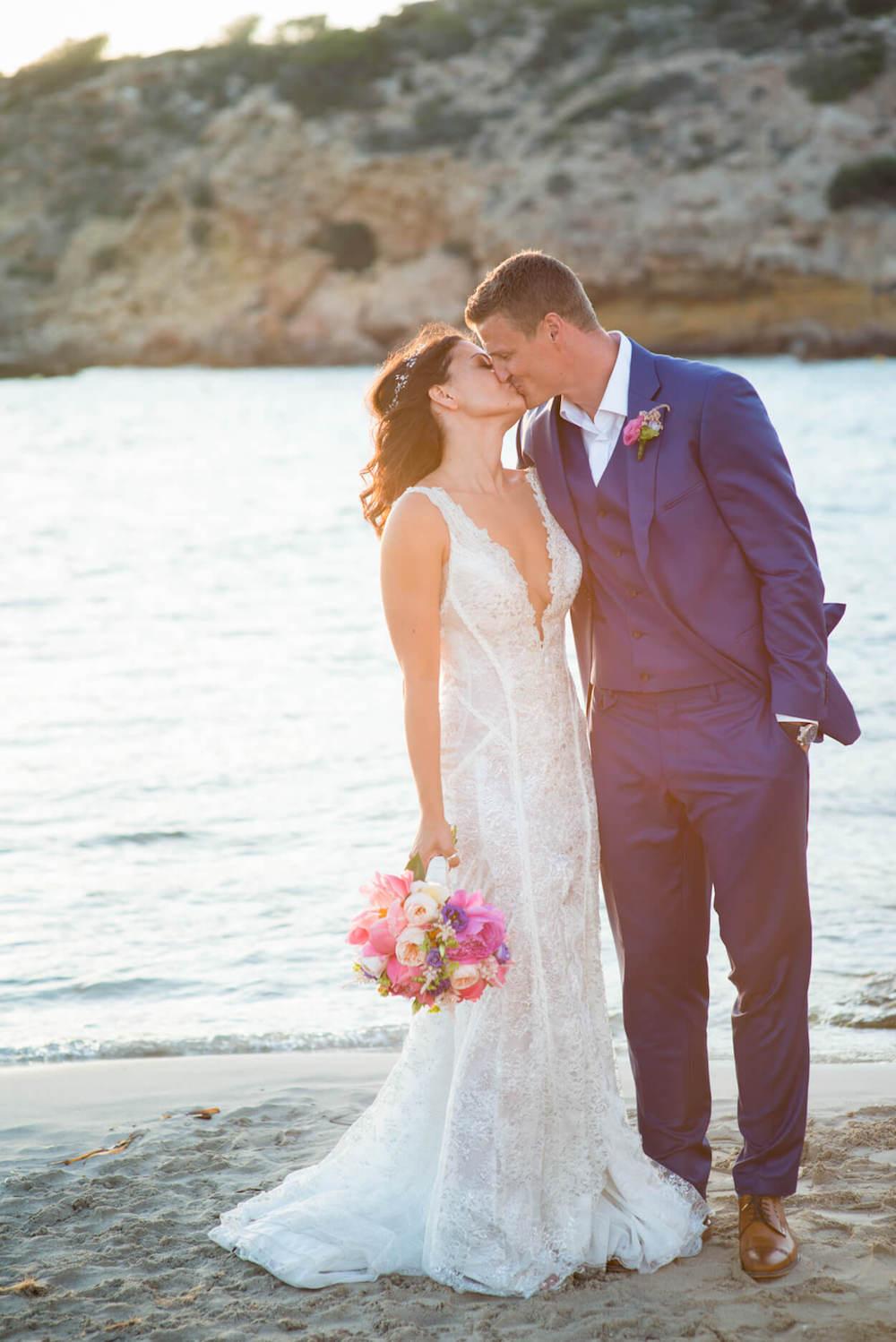 Colourful flowers wedding bouquet bride groom kiss beach venue sunset view Galai Lahav