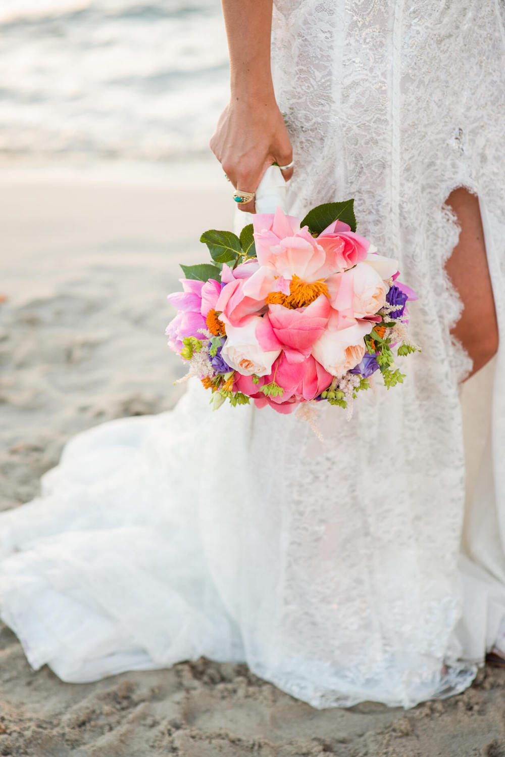 Colourful flowers bouquet wedding bride beach venue sunset view Galai Lahav