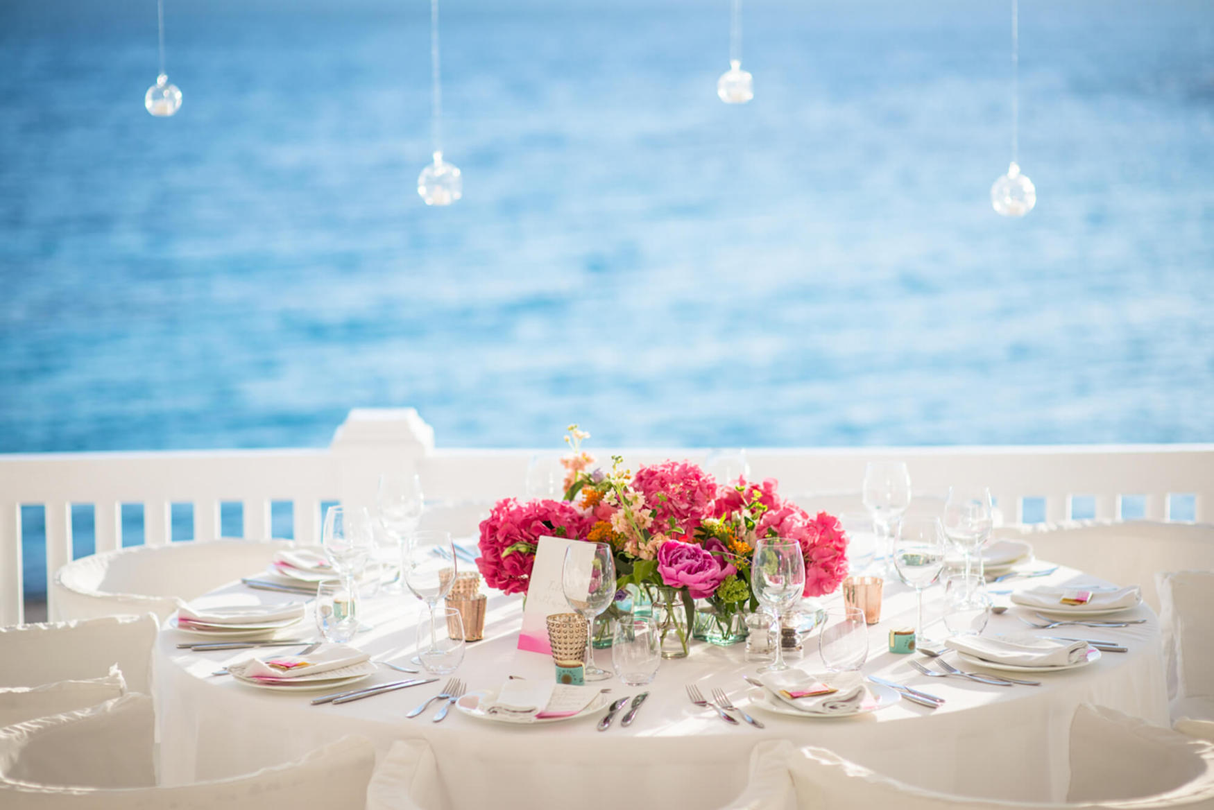 Colourful flowers centre piece beach venue sunset view Galai Lahav