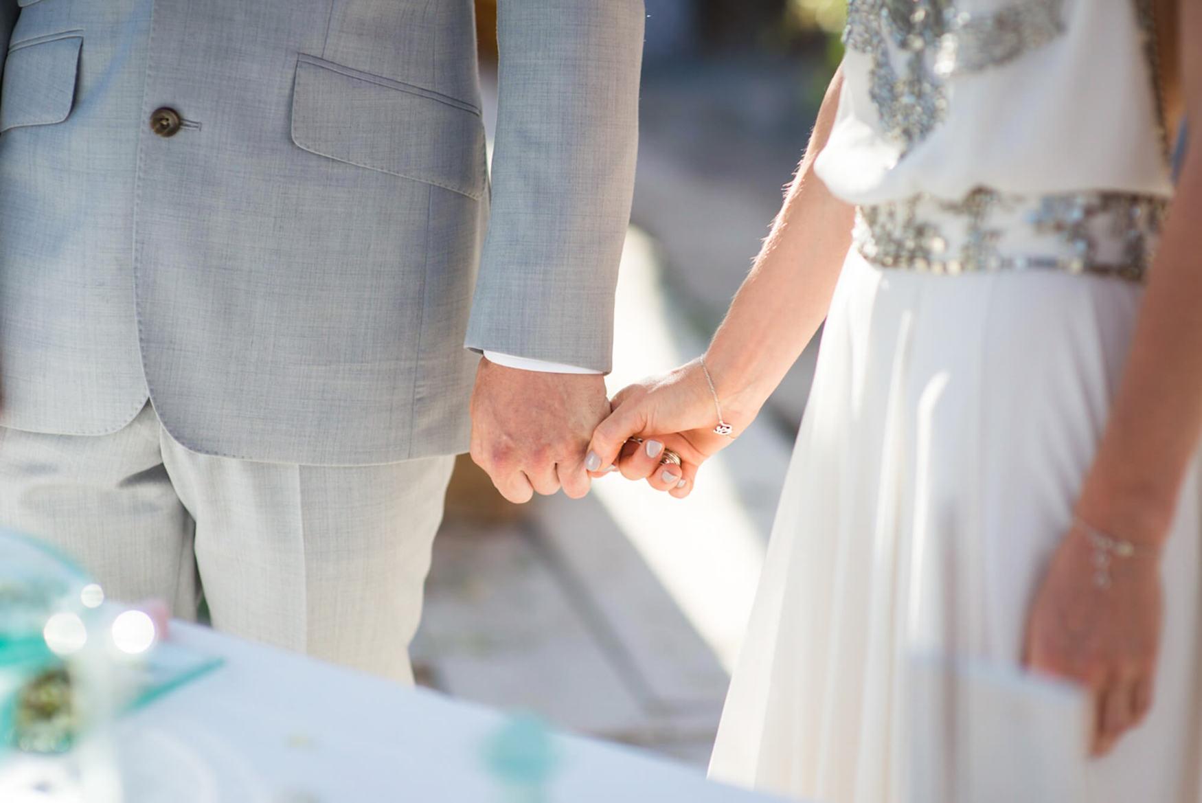bride groom hand detail beach wedding seaside happy laughter elements benirras amanda wakeley