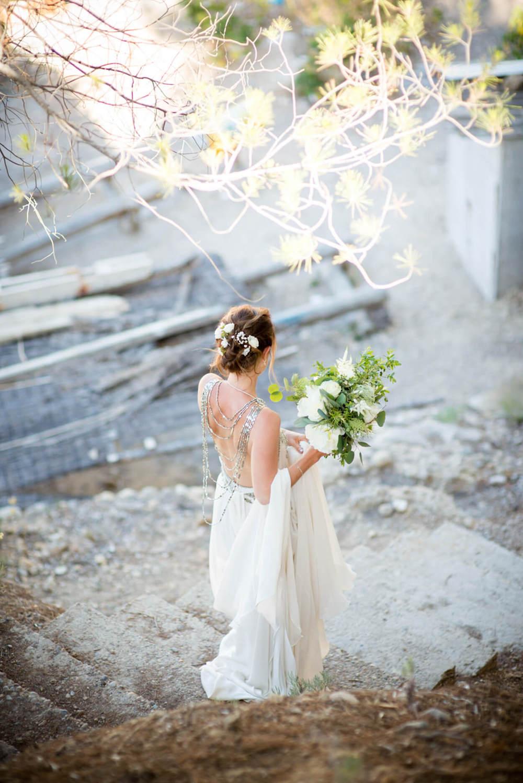 bride back dress silk amanda wakeley walk beach ceremony boat shack