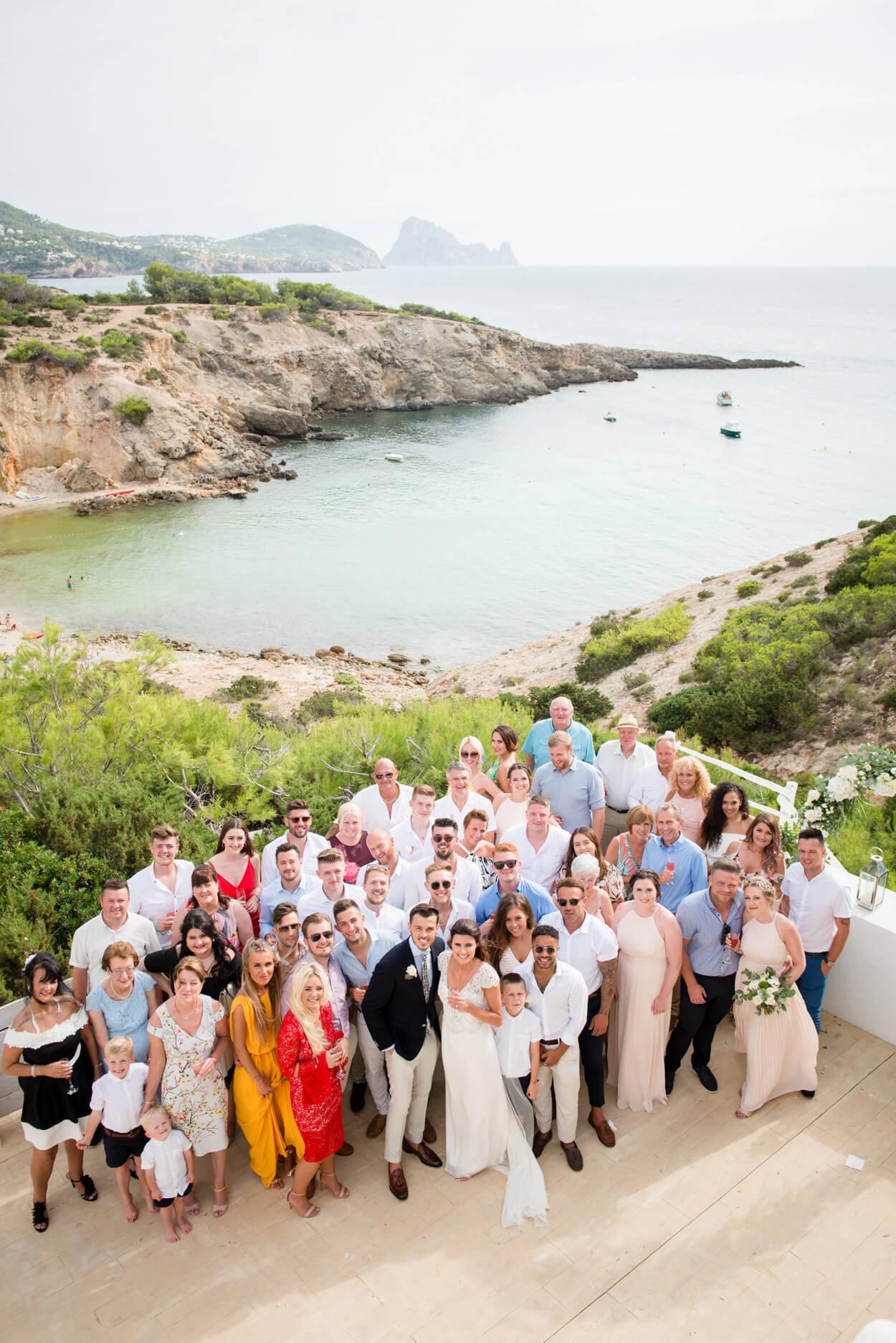 group wedding photo seaside wedding venue es vedra