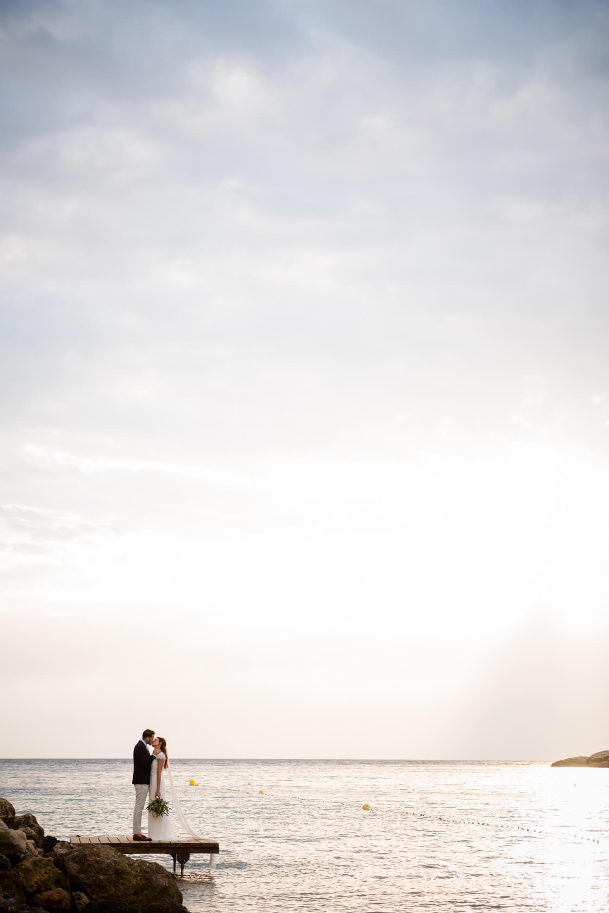 bride groom kiss couple portrait sunset beach sea view venue