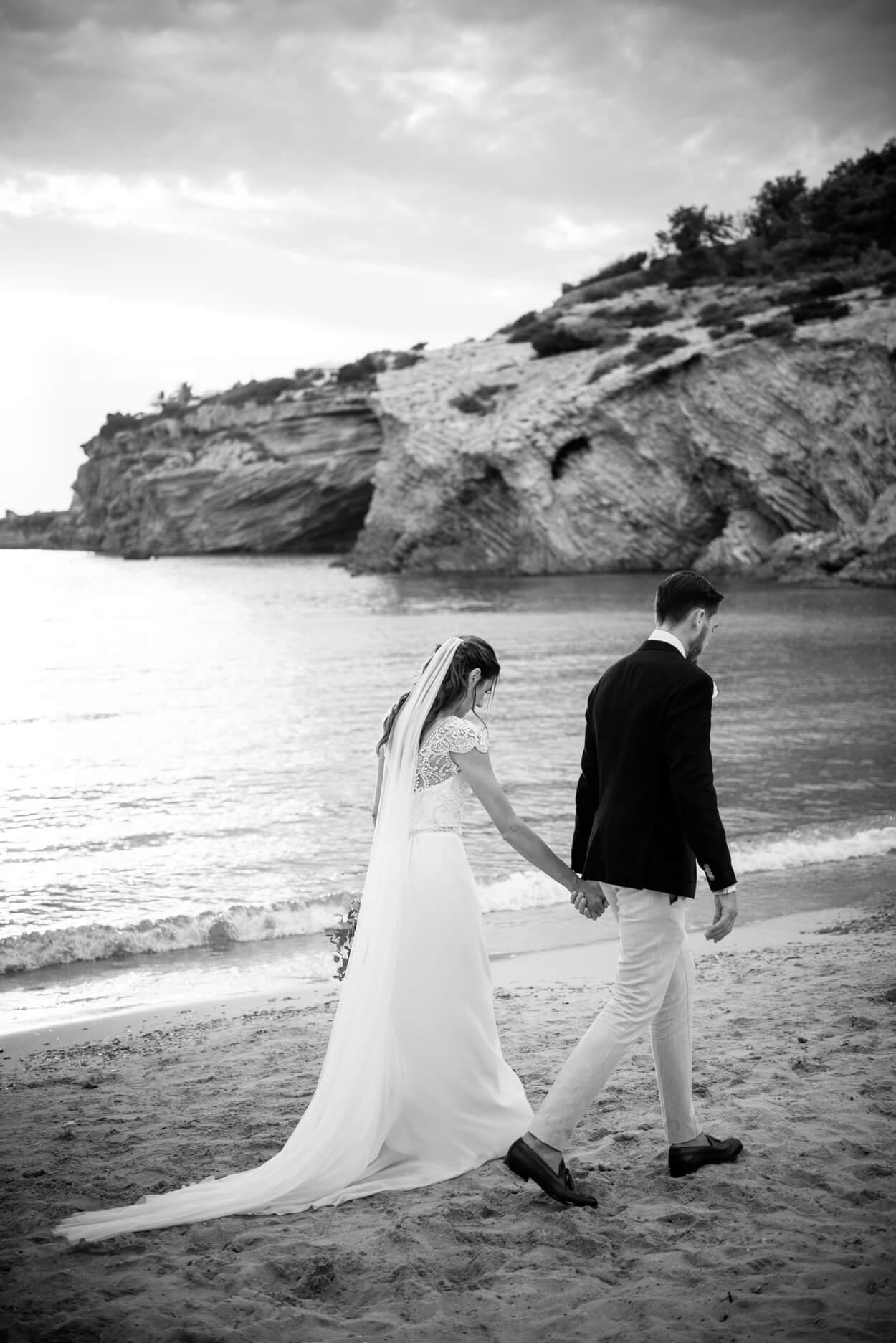 bride groom couple portrait sunset walking beach sea view venue