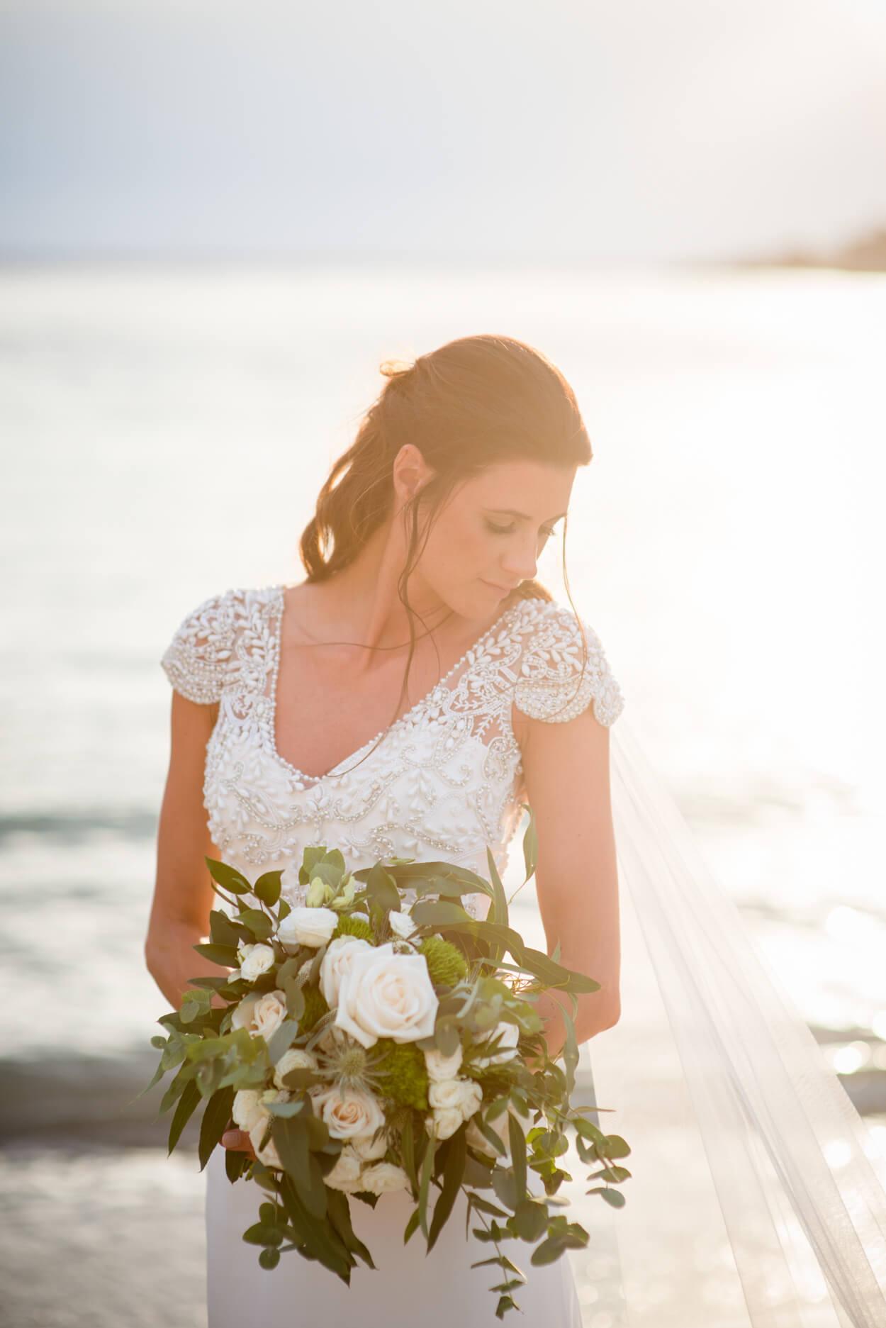 bride portrait sunset beach sea view venue wedding white roses flowers