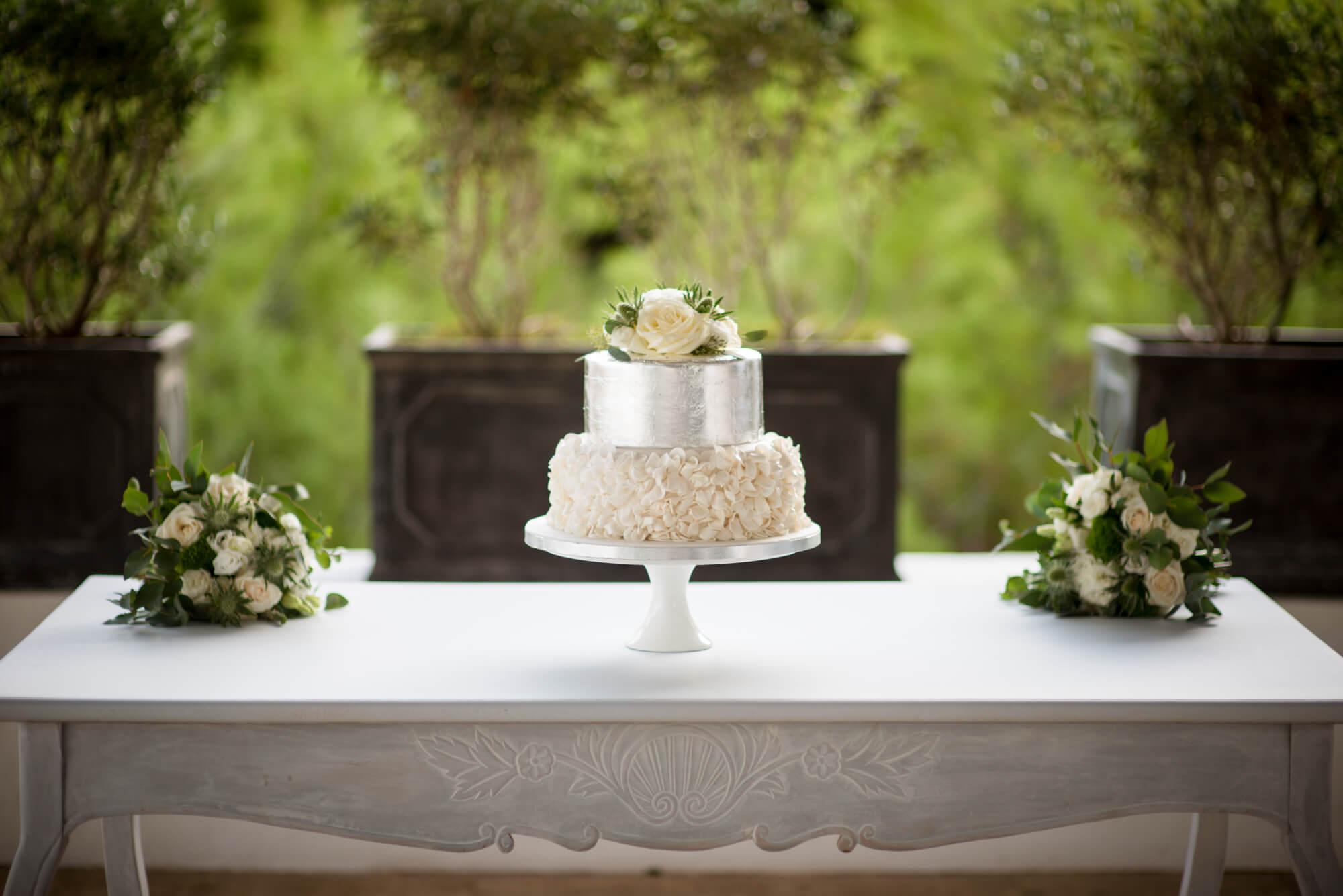 silver flower wedding cake sunset venue