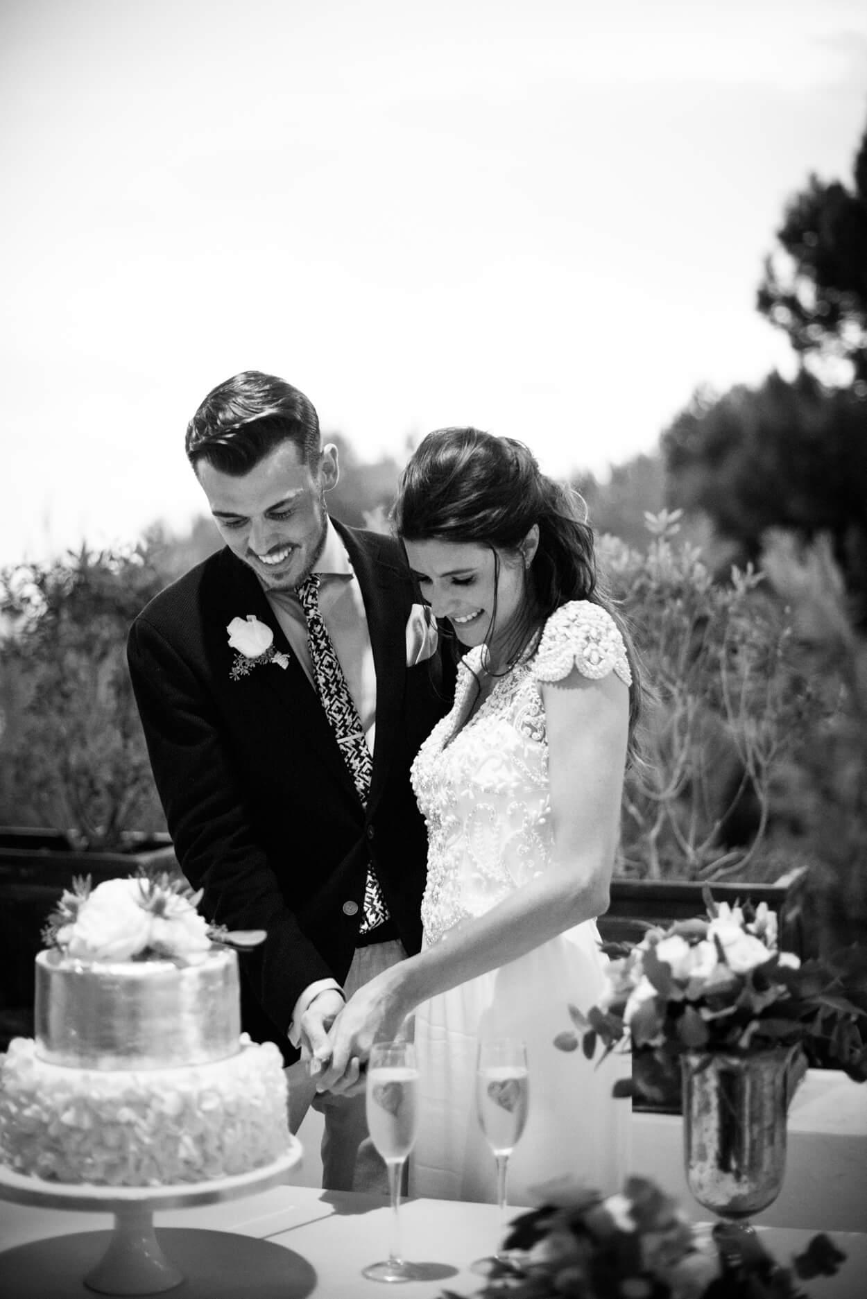bride groom sliver wedding cake cutting dusk light sunset venue