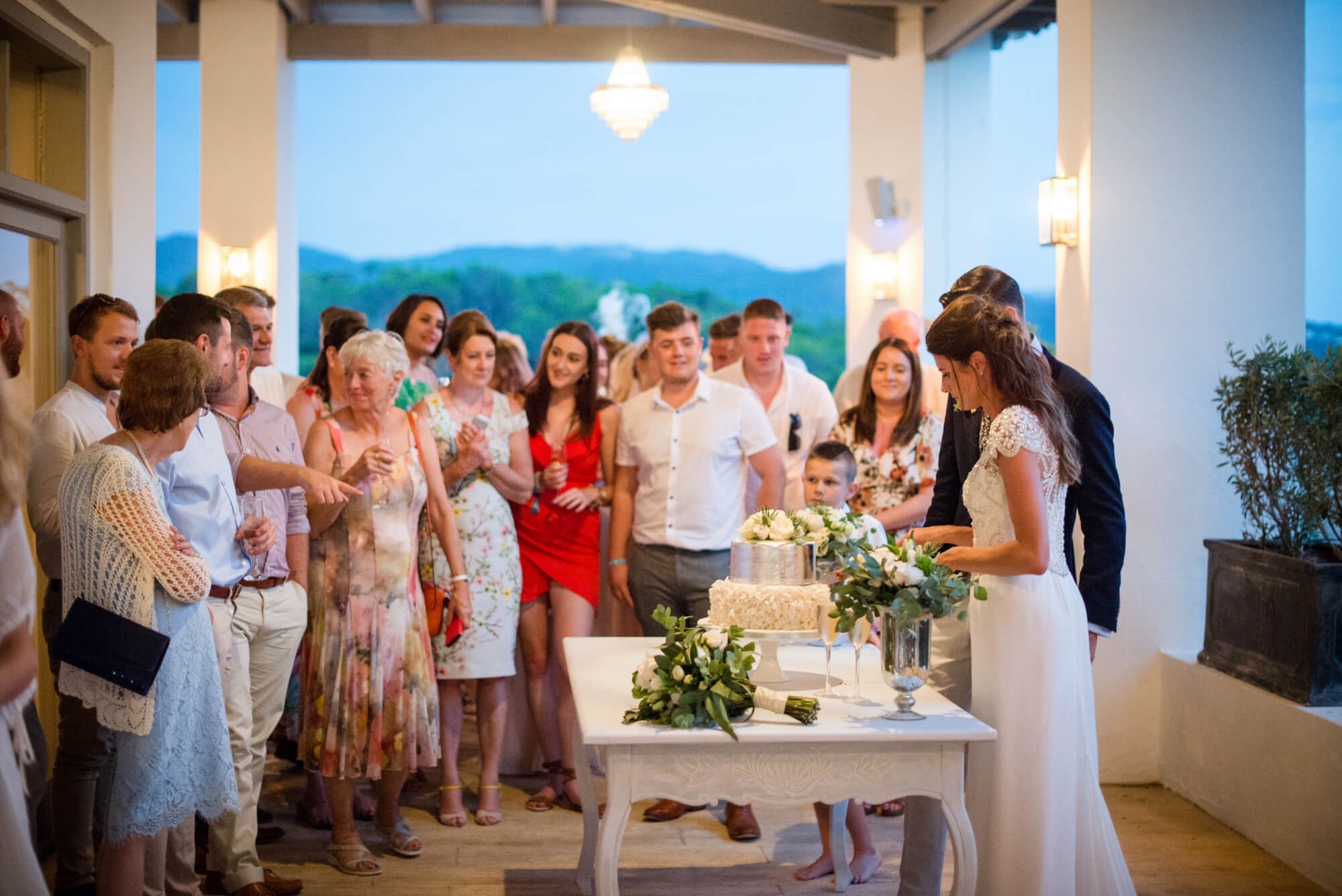 bride groom silver wedding cake cutting dusk light sunset venue