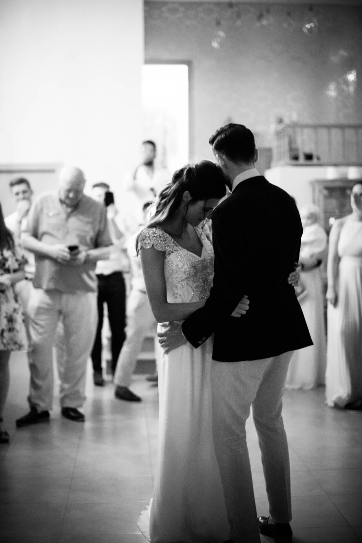 bride groom first dance black and white grain photo