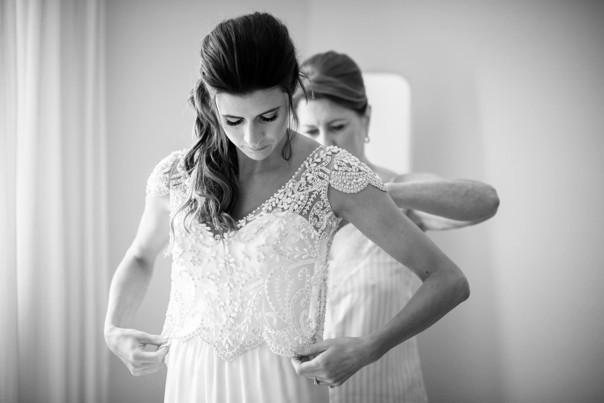 bride getting ready silk wedding dress veil mother of bride