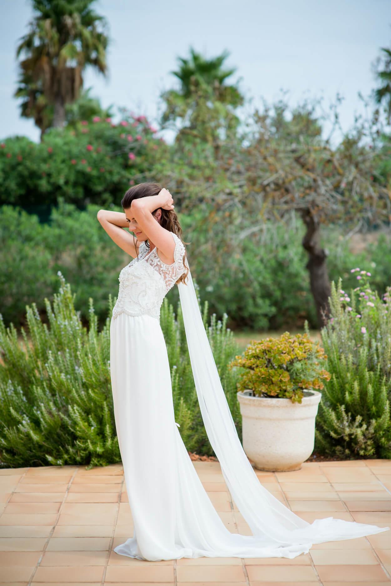 bride getting ready silk wedding dress veil