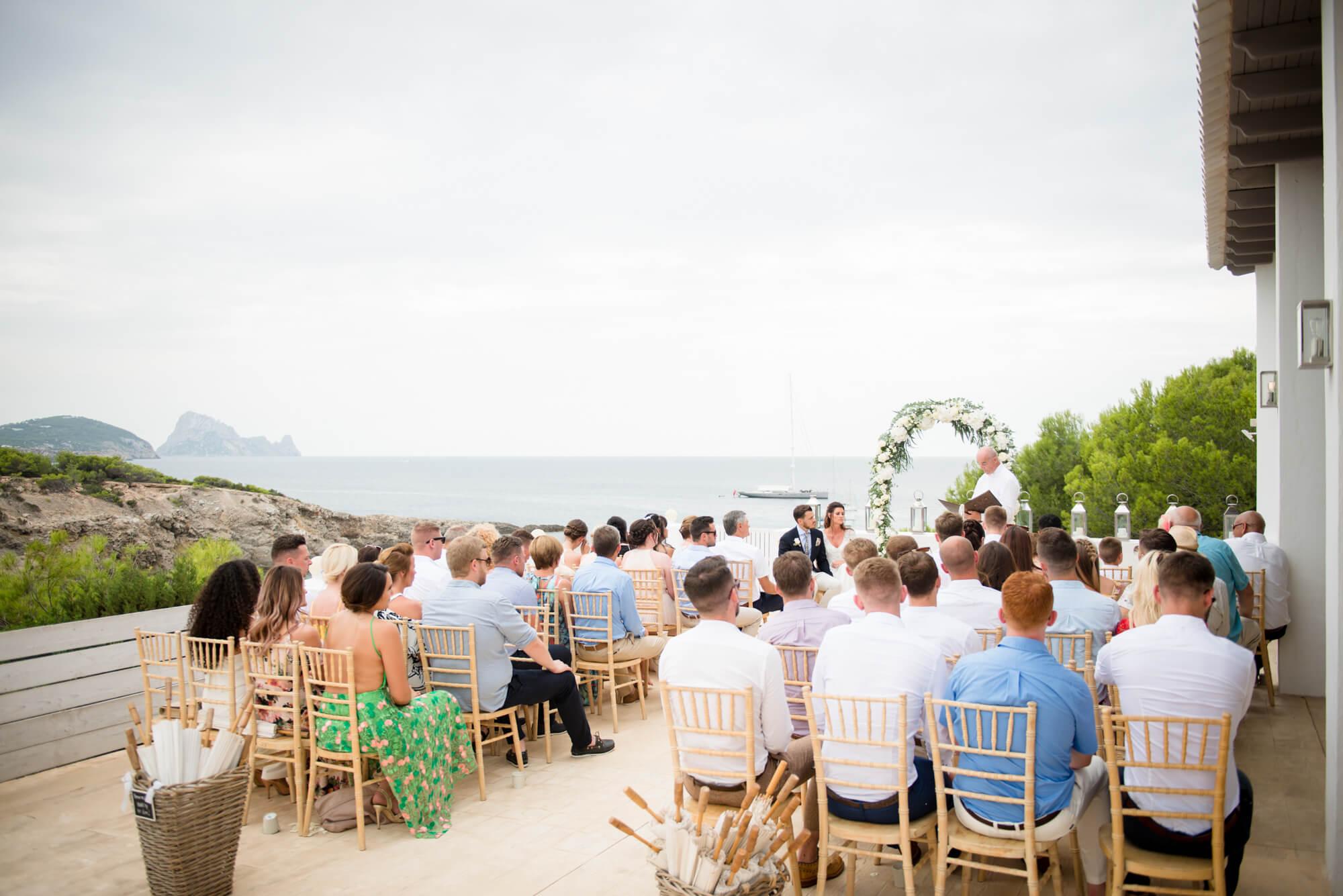 wedding ceremony venue seaside viw es vdra white flower arch