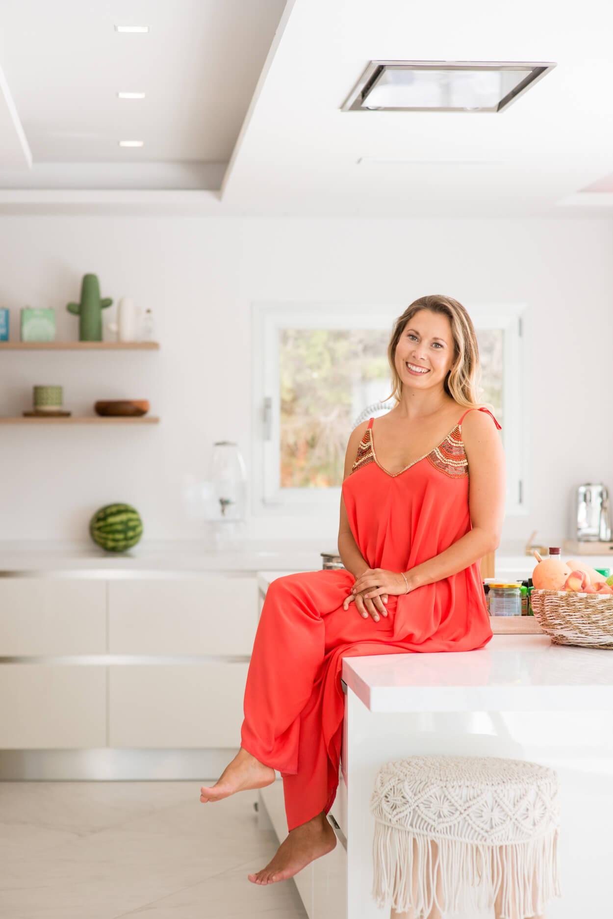 Nadia portrait woman health coach at home kitchen