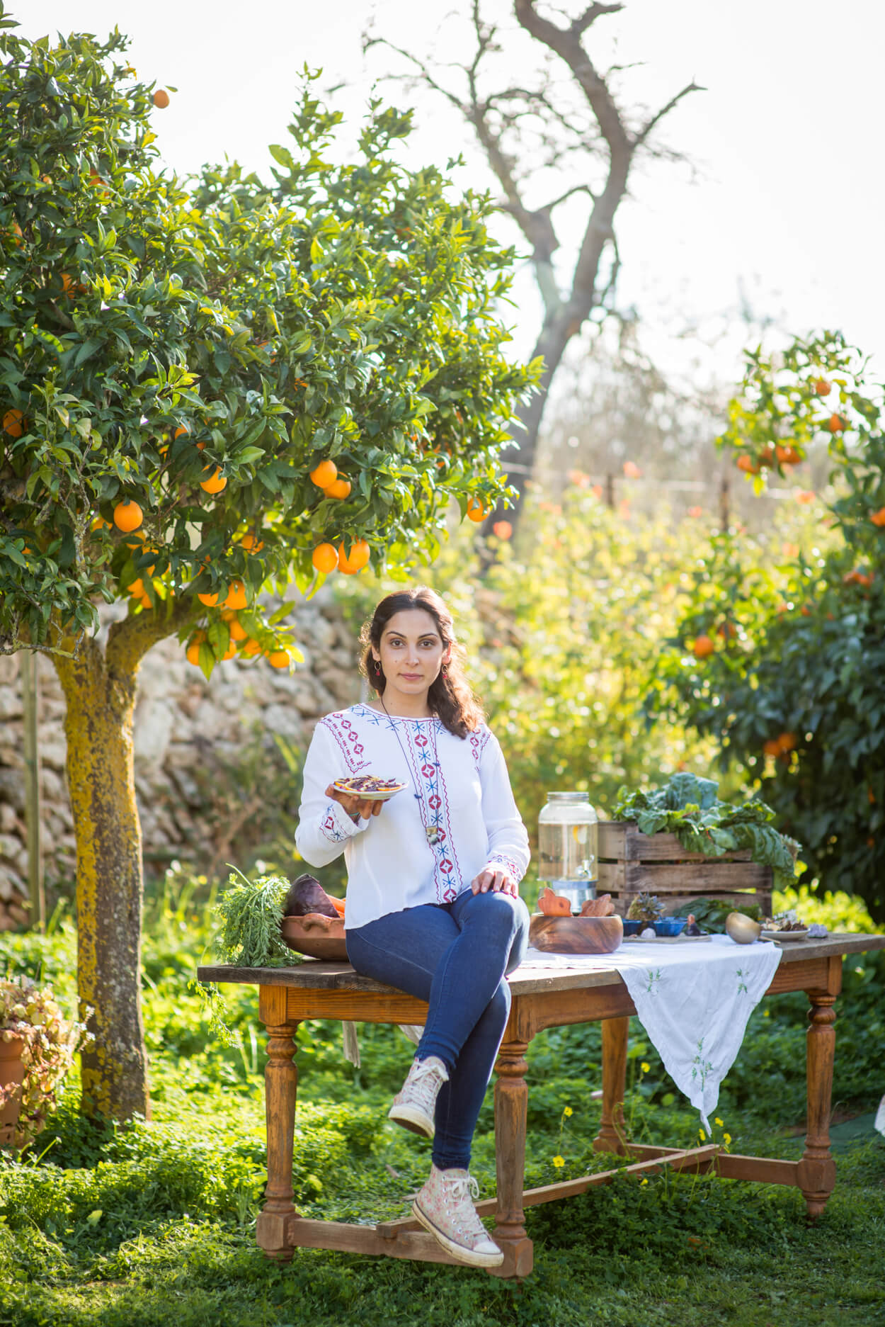 portrait plant base cook surrounded by orange trees