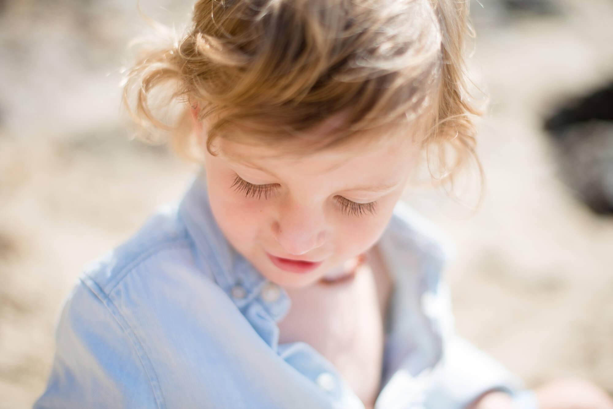 boy children portriat on beach natural light