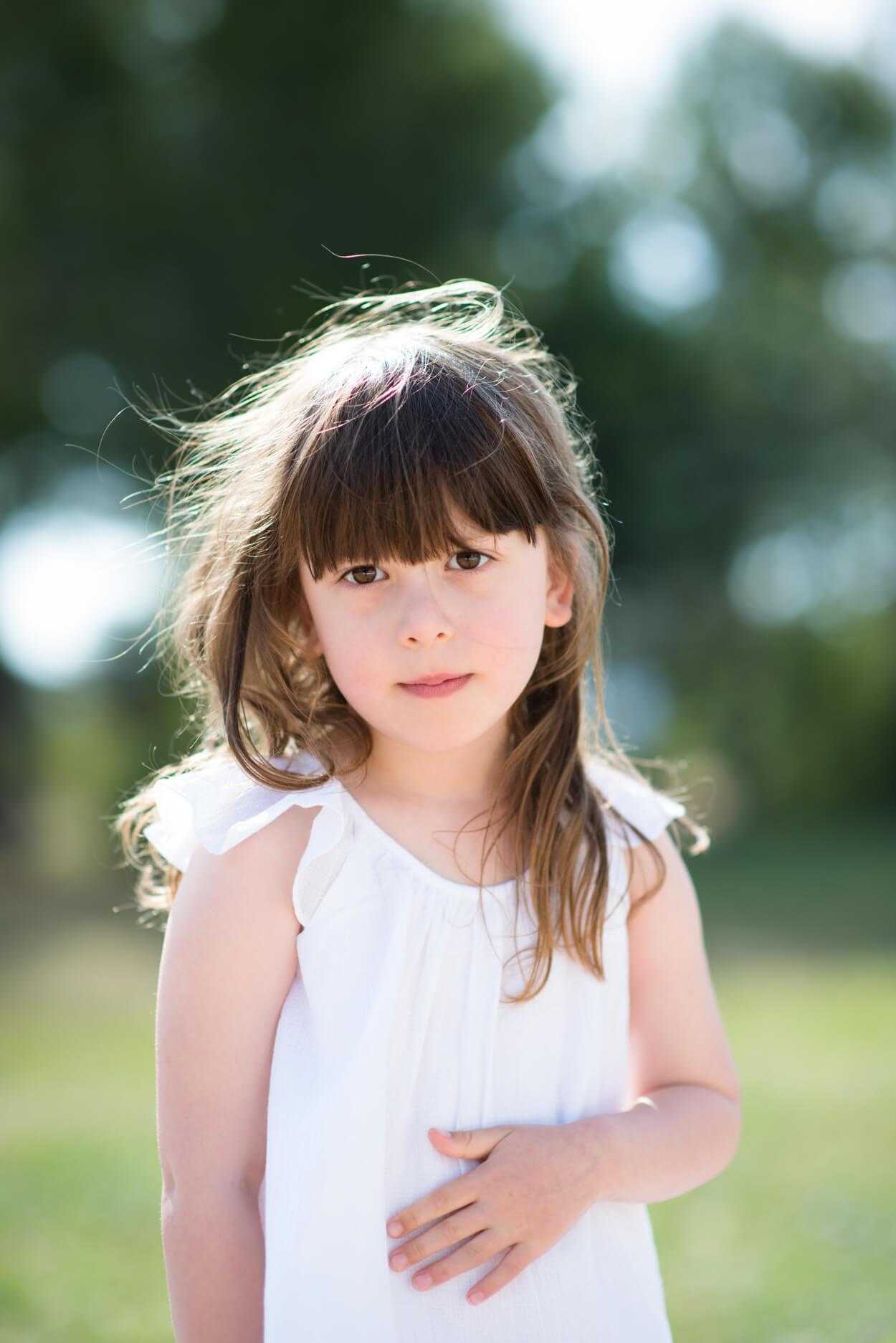 children kids portrait girl looking st camrea sun in hair natural light