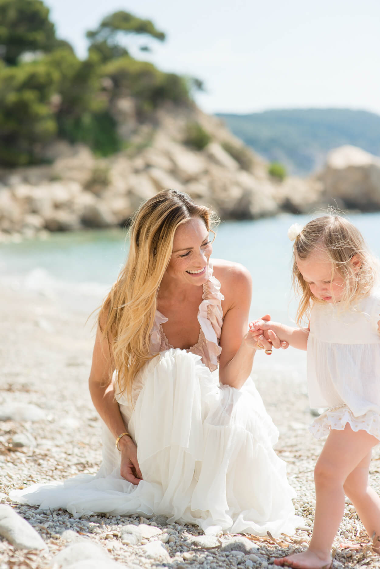 mother and daughter beach family portrait holiday home morning sunlight
