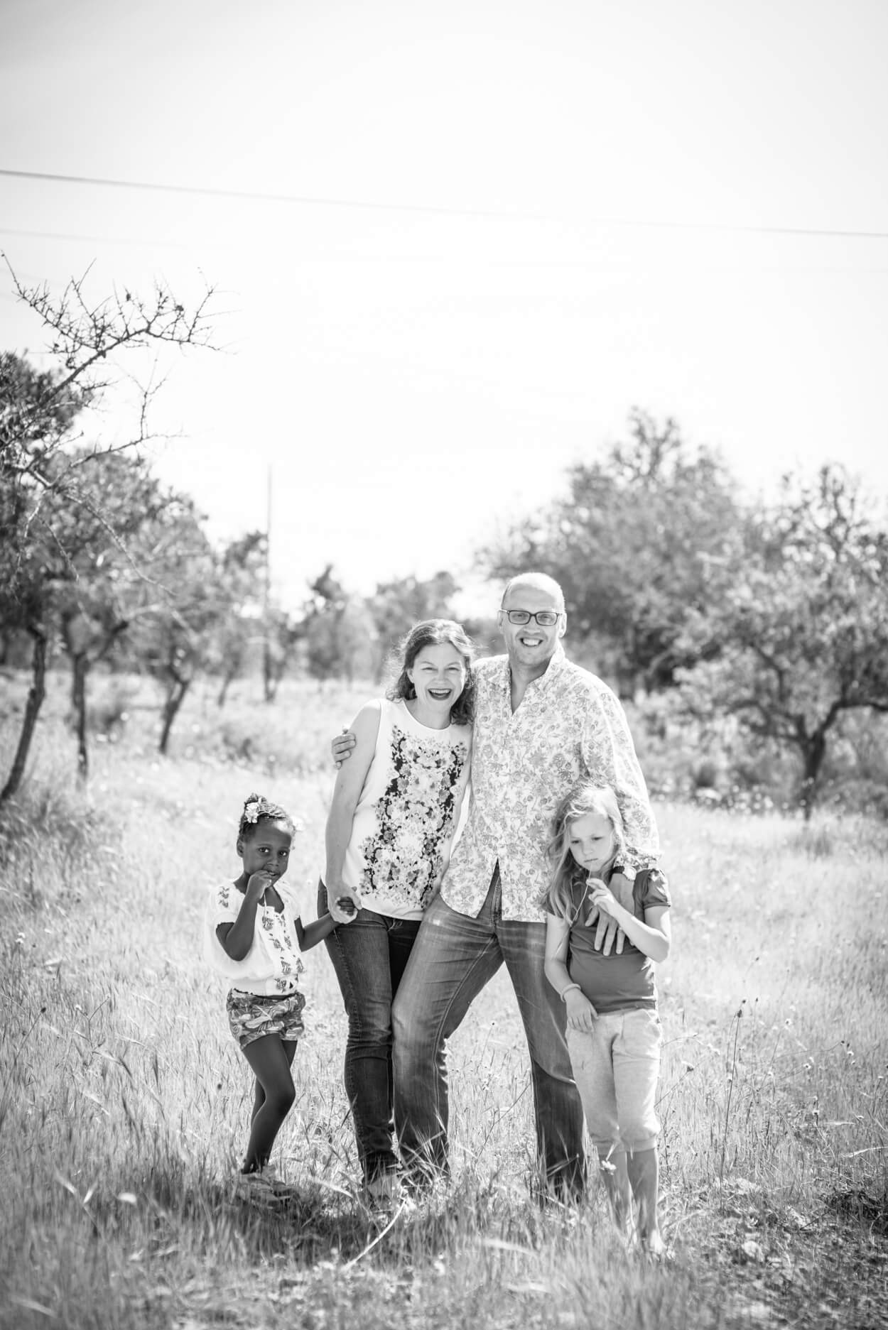 parents kids portrait countryside summer field natural light