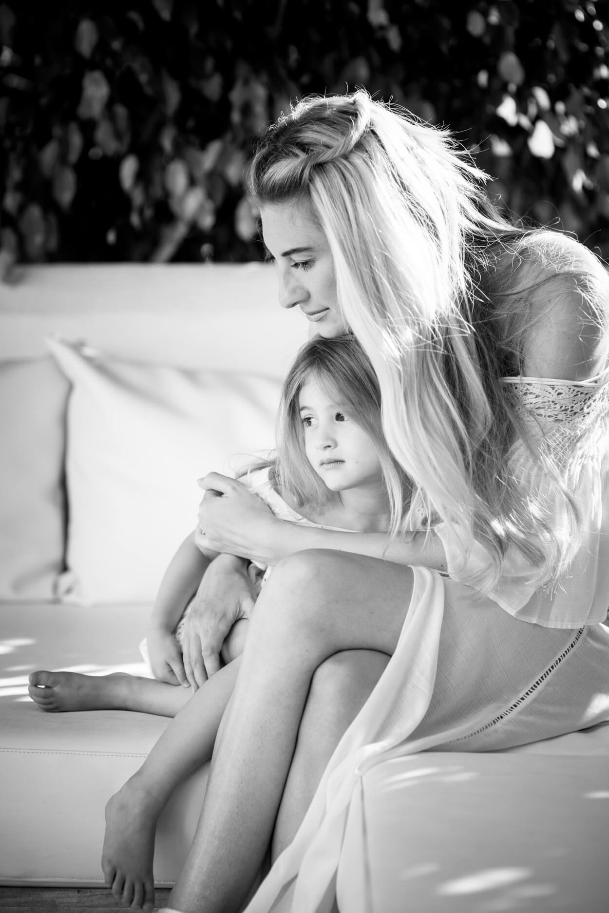 mother daughter cuddle portrait holiday home