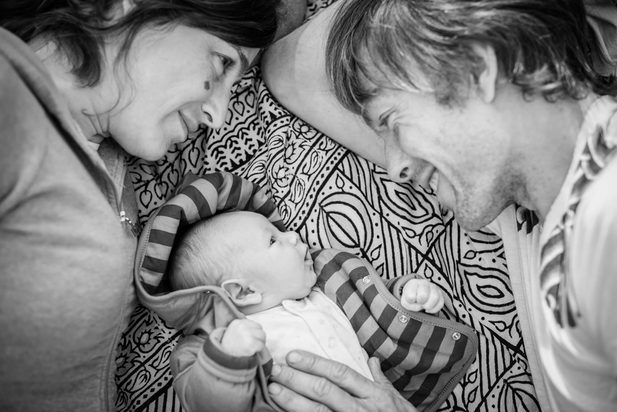 newborn father and mother portrait form above