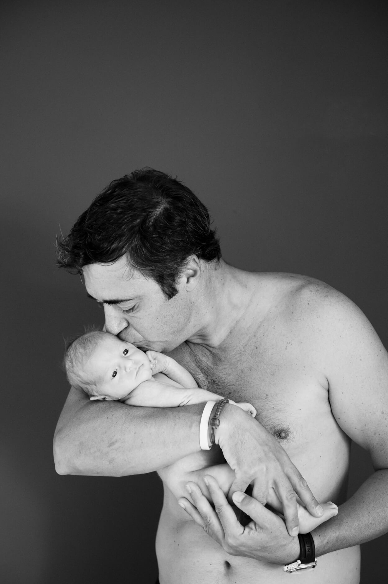 newborn father and child portrait home studio