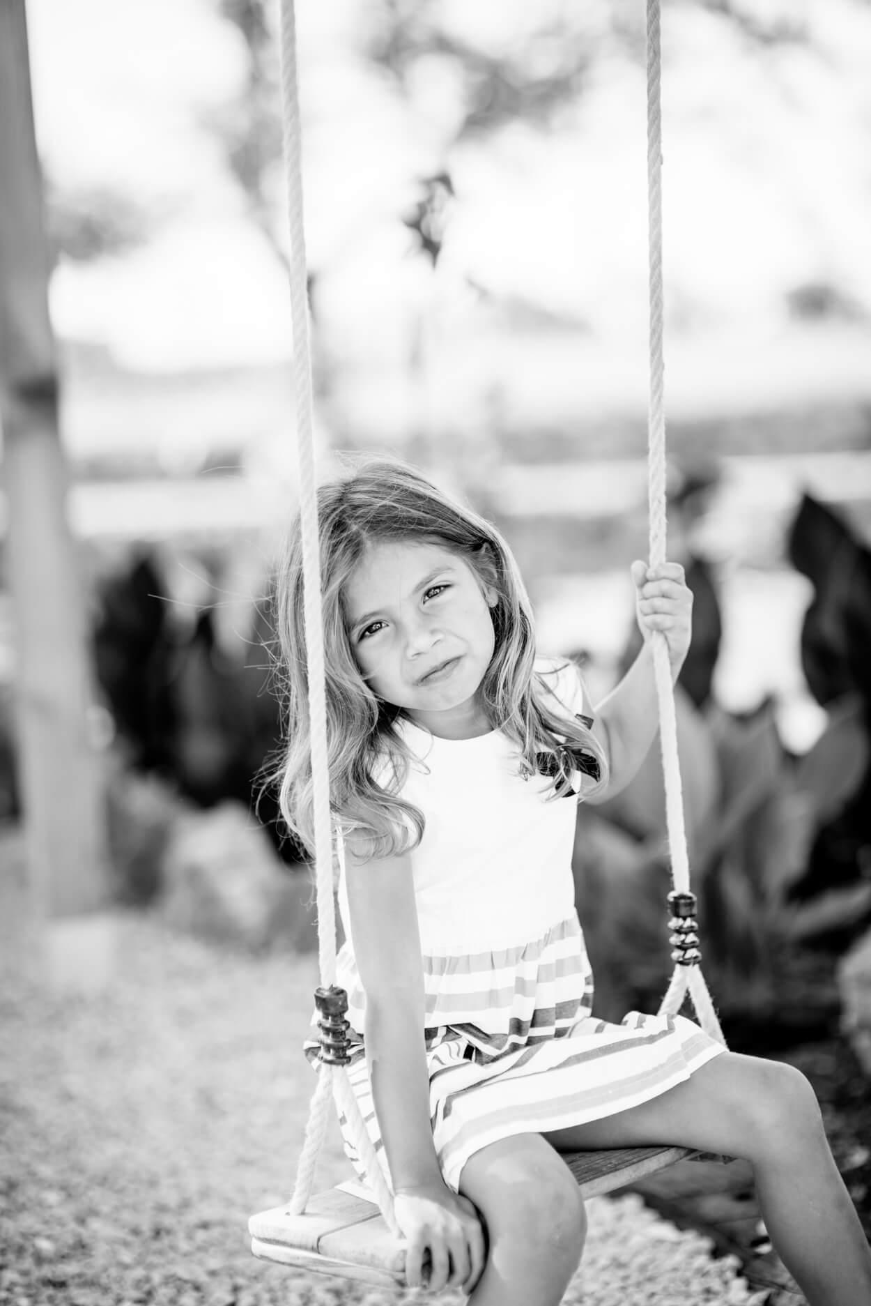 girl on swing children portrait home ibiza