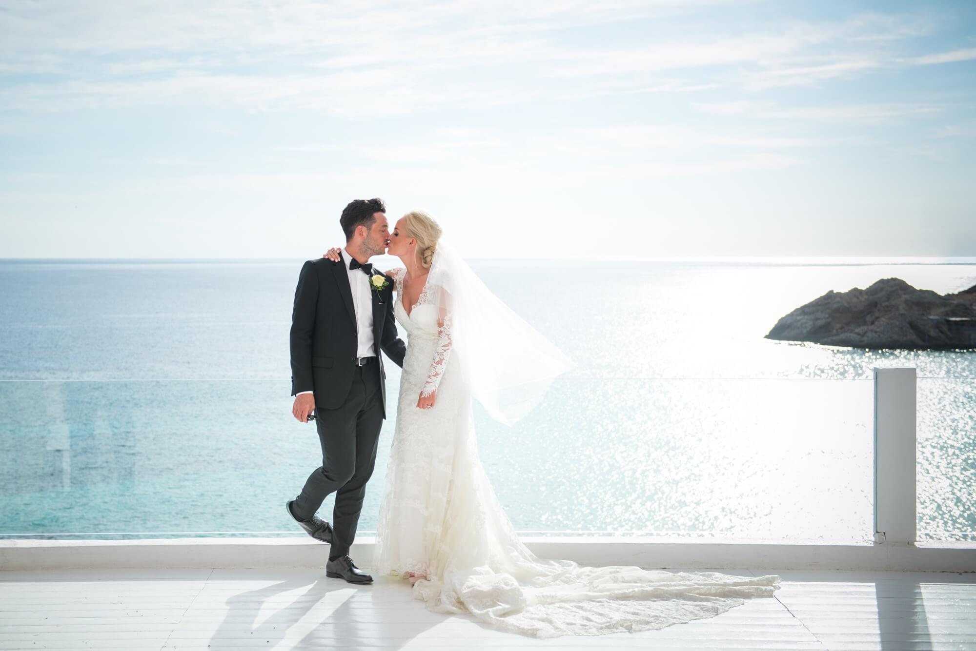 black tie lace wedding dress couple portrait kiss seaview venue horizon