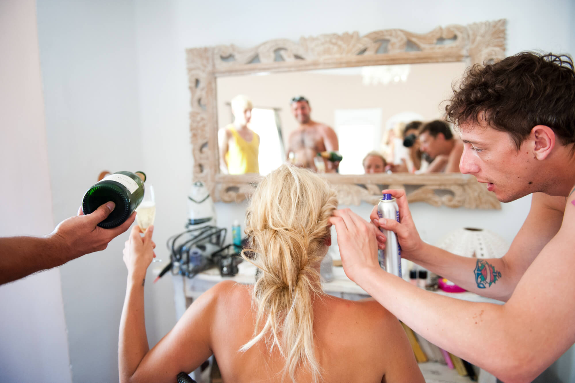 bride getting ready make up hair mirror reflection champagne