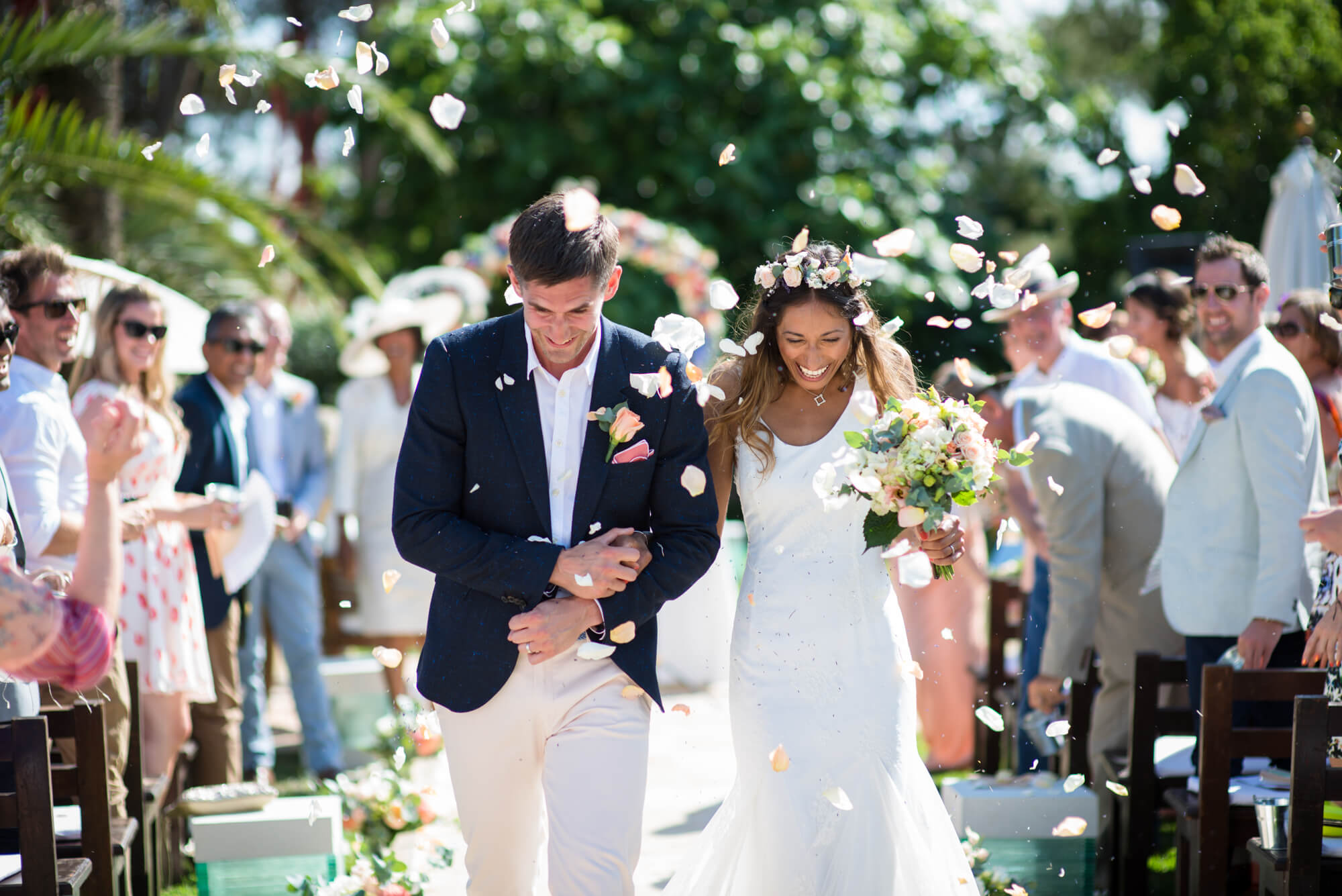 confetti moment petals just married bride groom walking aisle