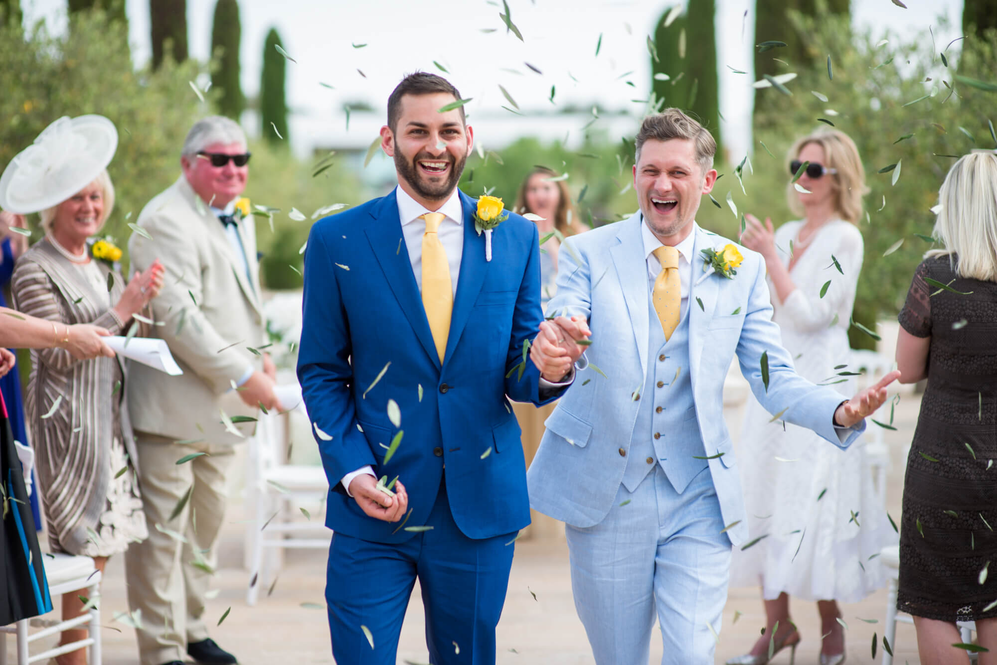 confetti moment olive tree leaves happy gay couple ceremony exit two grooms