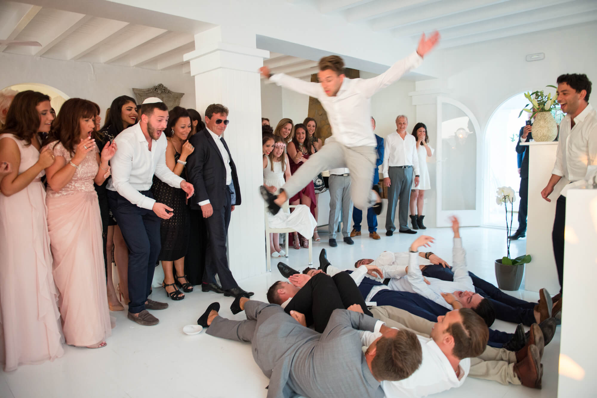 jewish wedding groom jump over guests seaview venue