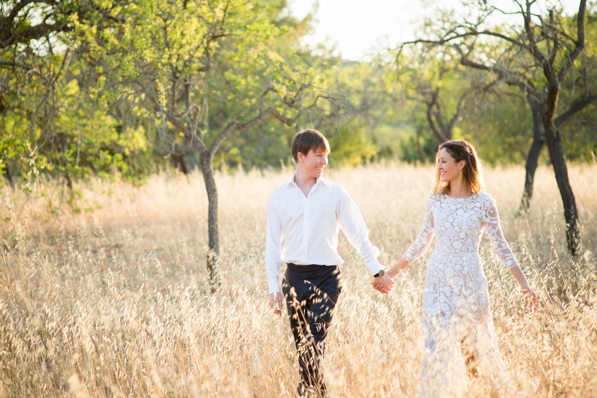 bride groom couple portrait spring field walk sunset golden hour
